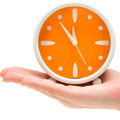 Orange Clock on Hand